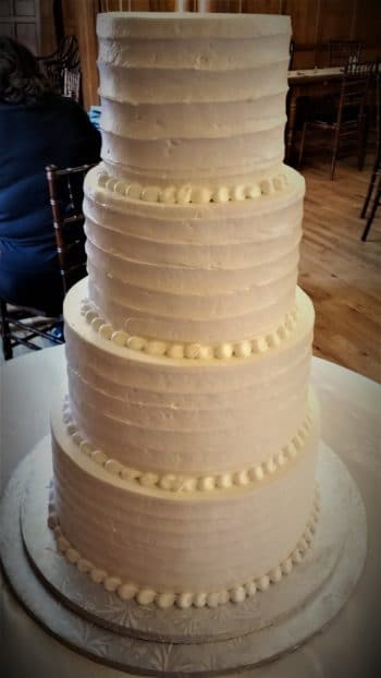 four tier frosted cake
