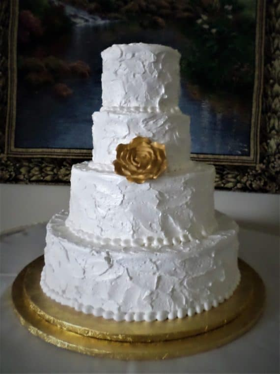 white and gold four tiered cake