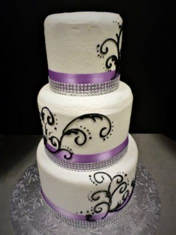 purple white black tier cake