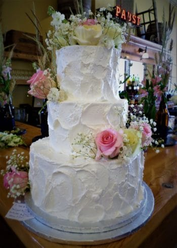 three tiered cake with flowers
