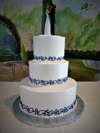 3 tiered blue and white cake
